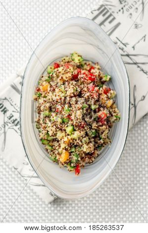 Top flat view of quinoa salad. Quinoa salads are very healthy and easy to do! Quinoa is a grain that originate from South America it's often called a super food due to its high nutritional content.