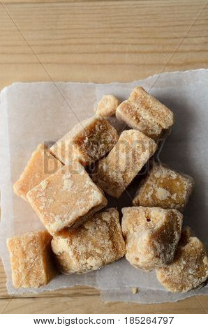 Fudge Pieces From Above On Parchment And Wood