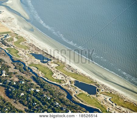 aerial view of golf course on the ocean