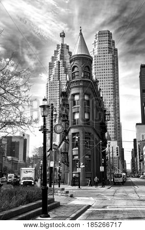 TORONTO CANADA JULY 10, 2017:  Gooderham Building is a historic landmark of Toronto, Ontario, Canada and is the focal poin in black and white
