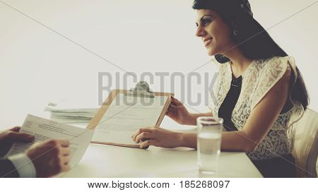 Customer and agent sitting at desk in a meeting or successful collaboration under man and woman