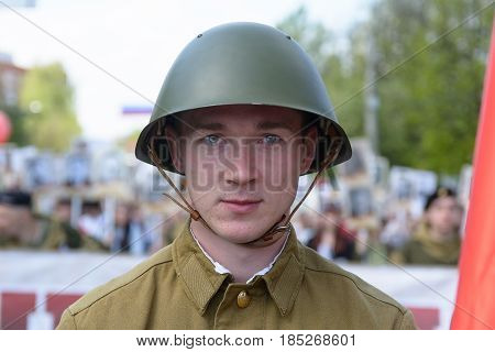 Yoshkar-Ola, Russia - May 9, 2016: Photo of a young man, dressed in a Soviet soldier in the form of a victory parade on May 9 in central city place.