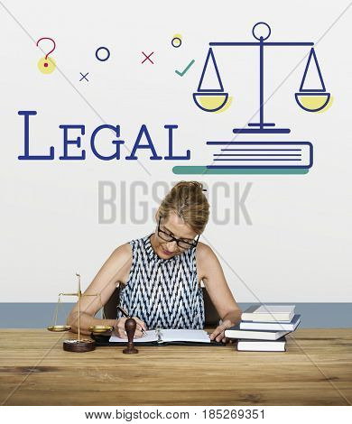 Woman lawyer sitting working with scale graphic icon