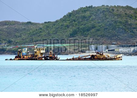 sunken ship partially above water, st martin, caribbean