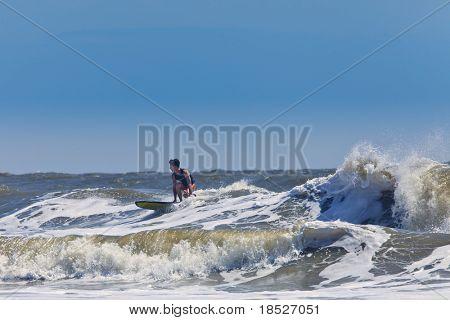 surfer riding waves on the atlantic coast of south carolina