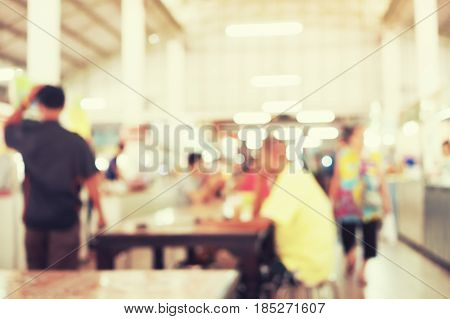 Defocused or blurred photo of food court for background.