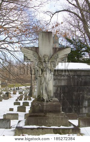Daytime exterior winter stock photo of angel headstone in Mount Hope cemetery in Rochester, New York in Monroe County