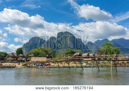 Wooden bridge across Nam Song river at Vang Vieng, Laos