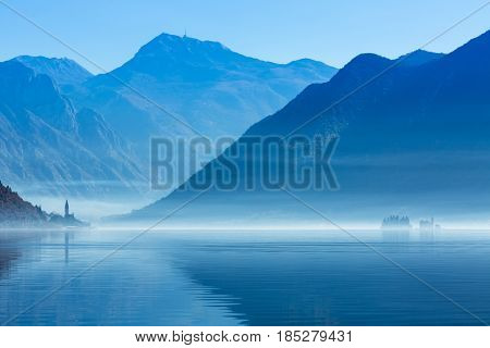panorama of Perast and islands in the fog. Montenegro.