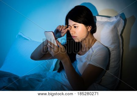 Woman Rubbing Eyes With Using Smartphone