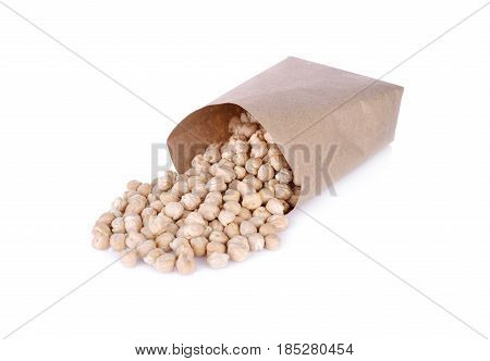 uncooked garbanzo bean in paper bag and on white background