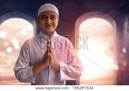 Muslim man smiling and greeting in mosque