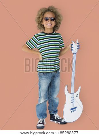 Portrait of a Little African Descent Boy with a Guitar Isolated