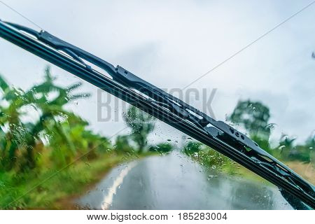 driving through the rain focus on the wiper and windscreen
