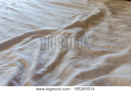 Texture of beige bedcover background texture .