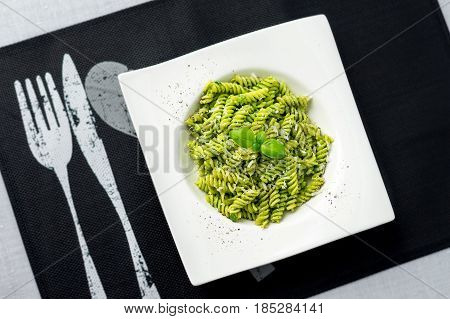 Pesto pasta from above. Rotini pasta with basil pesto sauce grated parmesan cheese and fresh pepper. This Italian dish makes a delicious meal by itself or can be used as a pasta salad side.