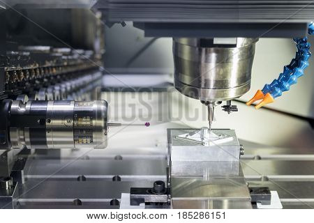 The CNC machine cutting work piece and the measurement probe in magazine.The hi-quality machining process concept.