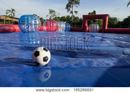 Zorb ball football game Field with ball.