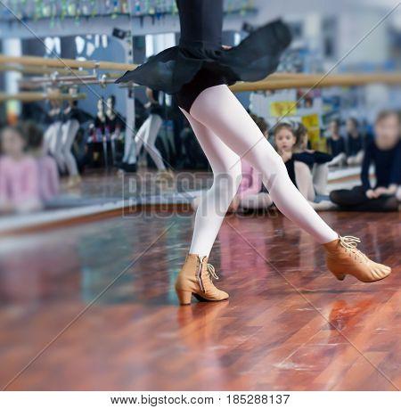 Ballerina Dancer Shoes. Training kid girl at school dance.