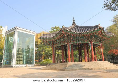 Wongaksa pagoda in Tapgol park in Seoul South Korea. Wongaksa pagoda was built in 1467 and stands in a protective glass case.