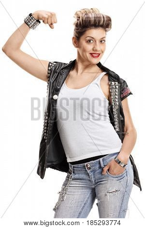 Punk girl flexing her biceps isolated on white background