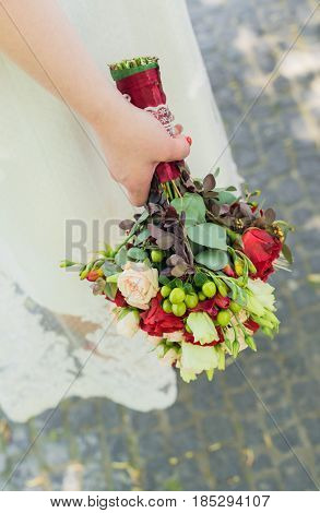 Wedding bouquet in the hand of bride.
