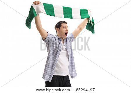 Ecstatic football fan holding a scarf and cheering isolated on white background