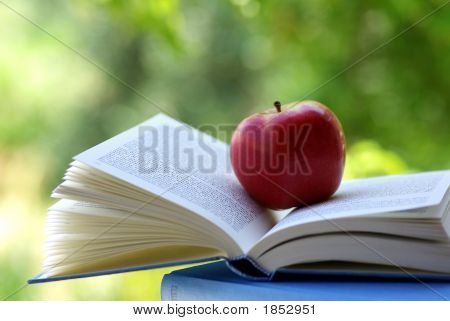 Red Apple On A Book