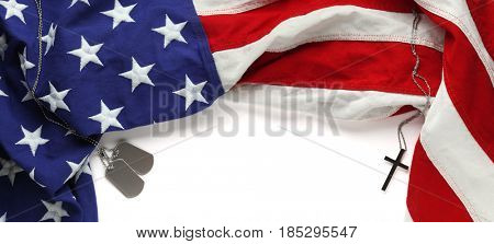 Red, white, and blue American flag with christian cross  and dogtags for Memorial day or Veteran's day background