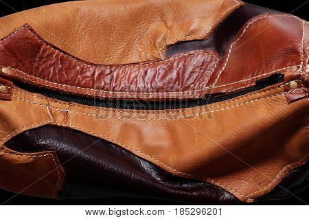background of a beautiful patterned leather bag.