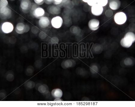 beautiful blurred black background with reflections and sparkles