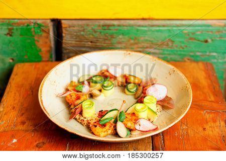 Healthy appetizer with quinoa and seafood on old wooden table, toned image