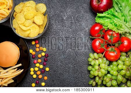 Healthy Nutrition Concept. Fruits And Vegetables Vs Unhealthy Fast Food And Sweets