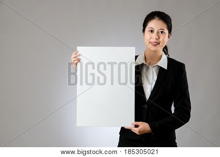 Businesswoman Holding A White Empty Banner