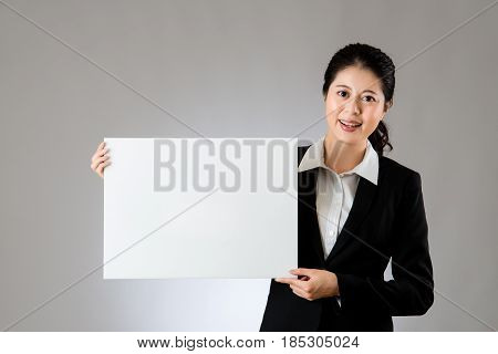 Smiling Business Woman Holding Blank Board