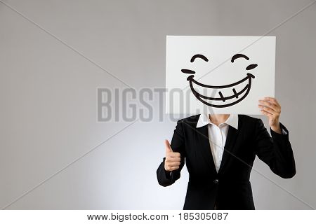 Holding Blank White Board With Thumbs Up