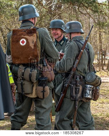 Gatchina, Russia - May 7, 2017: Historical reconstruction of the battles of World War II. German soldiers in full combat ammunition.
