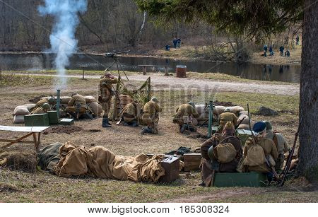 Gatchina, Russia - May 7, 2017: Historical reconstruction of the battles of World War II. Soldiers of the Red Army are firing mortars.