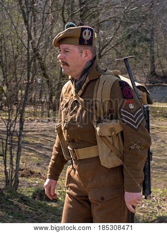 Gatchina, Russia - May 7, 2017: Historical reconstruction of the battles of World War II. Participant reconstruction in the form of a Scottish artilleryman.