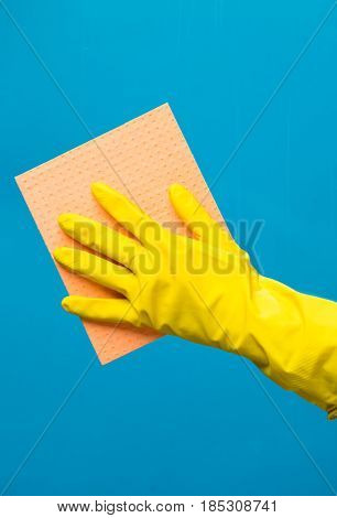 Man wiping window with rag