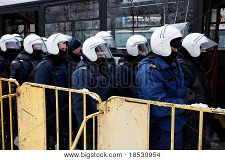 RIGA - MARCH 16: Riot police ready to prevent provocations at Commemoration of Latvian WaffenSS unit. Event is drawing crowds of nationalists & antifascist demonstrators. March 16, 2010, Riga, Latvia.