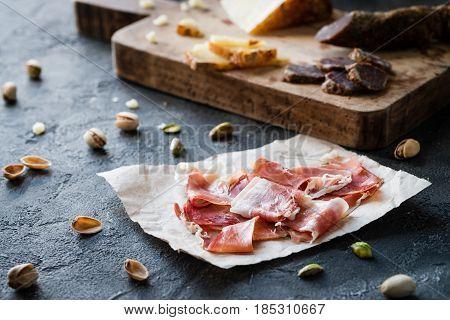 Spanish Ham Jamon Serrano Or Italian Prosciutto Crudo With Sliced Italian Hard Cheese Pecorino Tosca