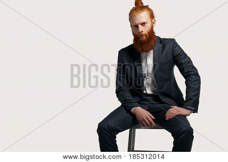 Serious ecological goods businessman hire new managers for a sale his product. Job interview concept to find new studetns after collage. Isolated cropped unformal office worker in black suite on chair