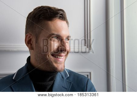 I choose happiness. Portrait of cheerful stylish bearded man. He looking aside with smile