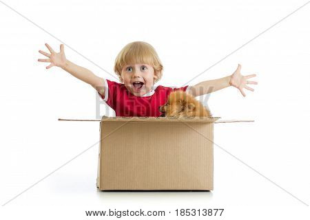 Smiling child boy and dog in cardbox isolated on white background