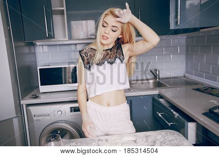 beautiful seductive girl in the kitchen HD