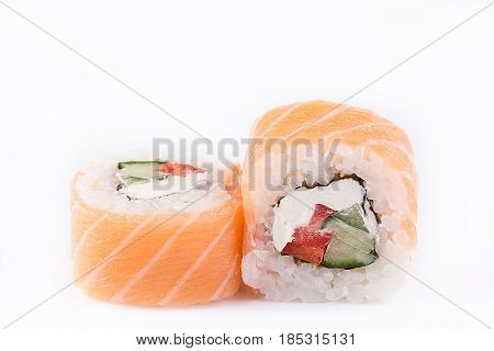 Japanese Cuisine, Sushi Set: Salmon Roll With Cucumber, Pepper And Cheese On A White Background.