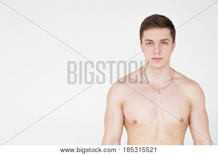 Studio Portrait Young Sexy Men Bodybuilder Athlete, With A Bare Torso, Standing In Full Length On A
