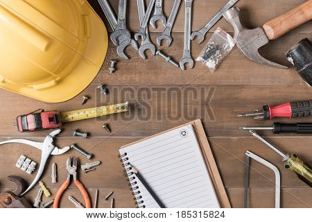 Blank Notebook And Tools Supplies On Wood Background