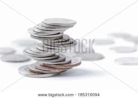 Coins Stacked On Each Other In Different Positions.